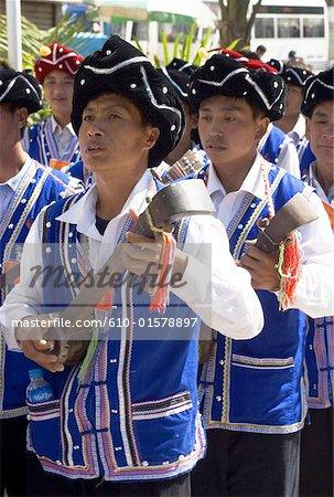 China, Yunnan, Lancang, Aini men playing the traditional string instrument