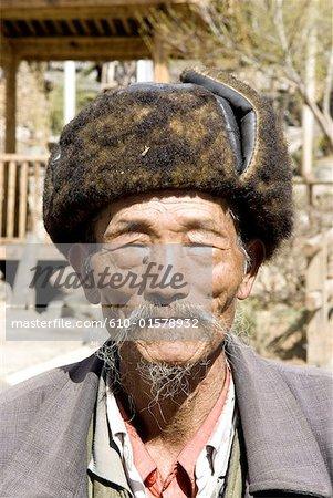 China, Yunnan, Lijiang, Naxi man portrait