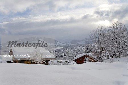 France, Alps, Megeve, chalets under snow