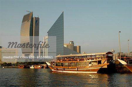 United Arab Emirates, Dubai, Creek Port, Bank of Dubai building and dhow at sunset