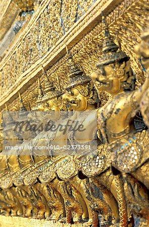 "Thailand, Bangkok, emerald Buddha temple ""Wat Phra Keo"", row of statues on a facade of the royal chapel"