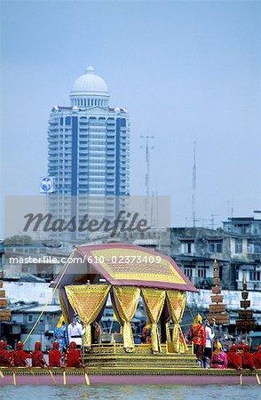 Thailand, Bangkok, Chao Praya river, royal barge during the yearly parade, oriental style skyscraper at rear