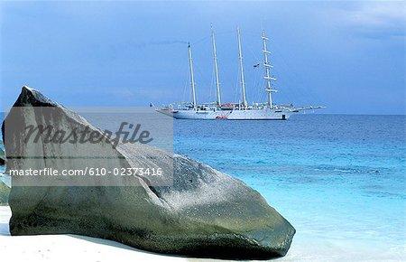 Thailand, Koh Miang island, beach and lagoon, granite rock and cruise boat lying at anchor