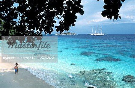 Thailand, Koh Miang island, beach and lagoon, cruise boat lying at anchor