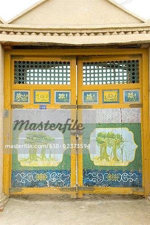 China, Xinjiang, Turpan, traditional Uyghur dwelling, painted doors