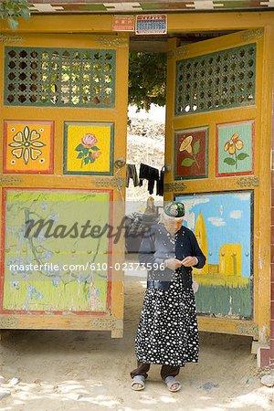 China, Xinjiang, Turpan, traditional Uyghur dwelling, old woman