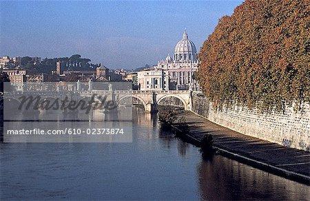 Italy, Rome, San Angelo Bridge on the Tiber River and Saint Peter's dome