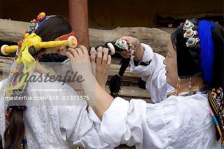 China, Sichuan, near Danba, Tibetan women preparing themselves for village festival