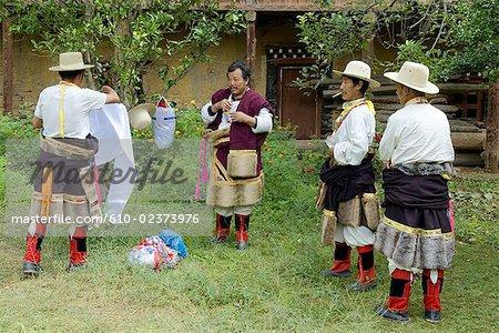 China, Sichuan, near Danba, Tibetans preparing themselves for village festival
