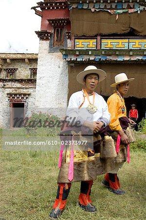 China, Sichuan, near Danba, Tibetan village festival, men in traditional costume