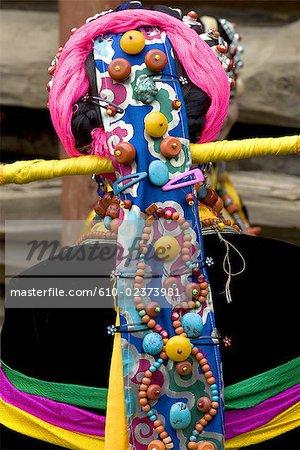 China, Sichuan, near Danba, Tibetan village festival, detail of woman coiffure