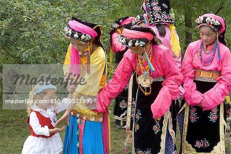 China, Sichuan, near Danba, Tibetan village festival, young girls in traditional costume