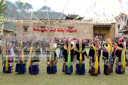 China, Sichuan, near Danba, Tibetan village festival, dance in traditional costume