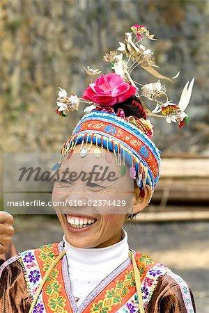China, Guizhou, Leishan, woman in traditional costume