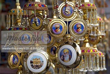 India, Punjab, Amritsar, locket depicting sikh gurus.