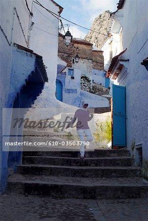 Morocco, Chefchaouen, medina, young woman