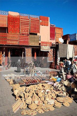 Morocco, Marrakech, souk, seller of carpets and souvenirs