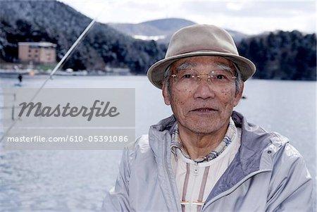 Japan, Hakone, lake Ashi, fisherman