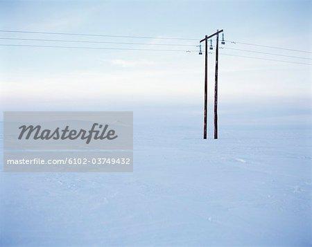 A power line in a winter landscape.