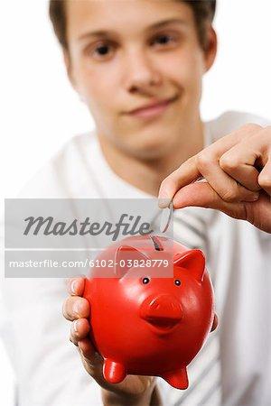 A boy with a piggy bank.