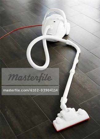 A white vacuum cleaner on the floor, Swedne.