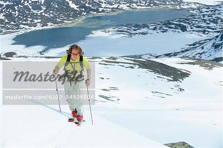 Man telemark skiing in mountain scenery
