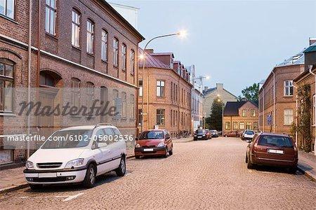 Cars on cobblestone street
