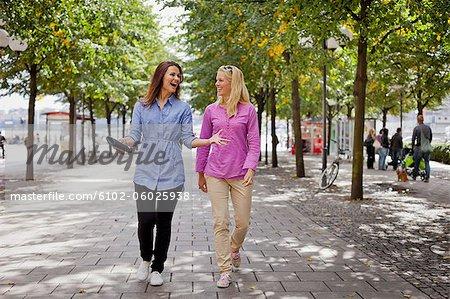 Two friends walking in park