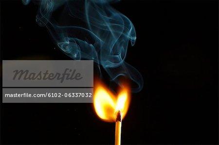 Studio shot of burning match
