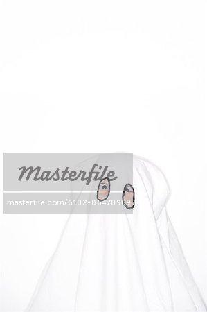 Child in ghost costume, studio shot