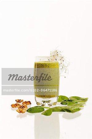 Green smoothie on white background, studio shot