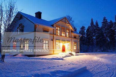 Illuminated house at dusk