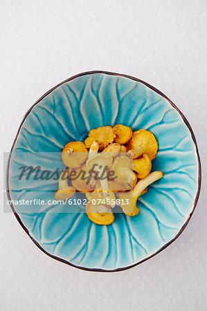 Cherries in blue bowl, studio shot