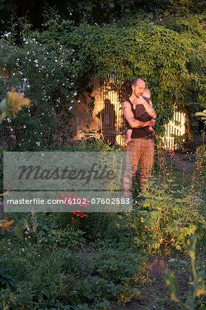 Father hugging daughter in garden