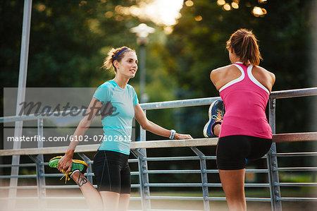 Female runners stretching, Uppsala, Sweden
