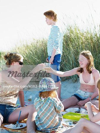 Family having picnic, Skane, Sweden
