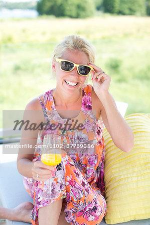 Smiling woman relaxing in garden, Stockholm, Sweden