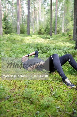 Tired runner in forest
