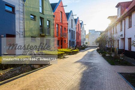 Multi colored buildings along footpath