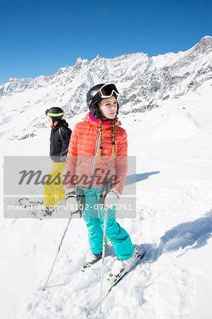 Skiers looking away