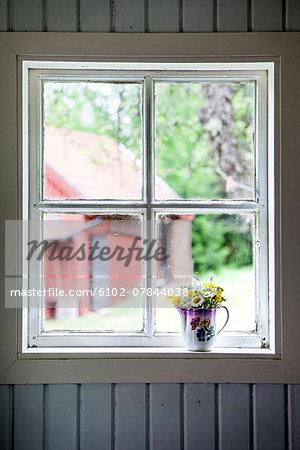 Wildflowers in jug on windowsill