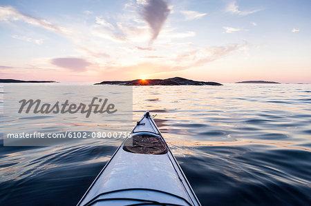 Kayak on water at sunset