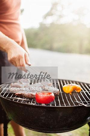 Man having barbecue