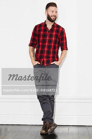 Young man wearing checked shirt, studio shot