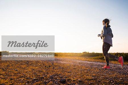 Woman running at evening