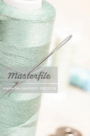 Thimble and needle, close-up