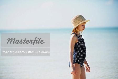 Girl in swimsuit by sea