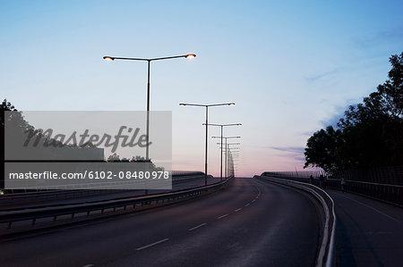 Lights above highway at dusk