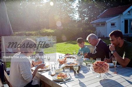 Family having dinner in garden