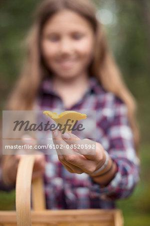 Girl holding mushroom